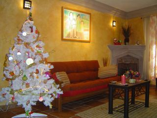 San Miguel de Allende house photo - Casita Canela Living Room and Fireplace during Christmas Season