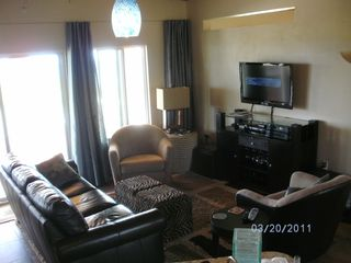Cayman Brac house photo - Living room open to kitchen and dining, flat screen TV and comfortable furniture