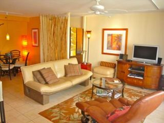 Waikiki condo photo - Living Rm with fine leather furniture & original artwork.Dining area to the rear