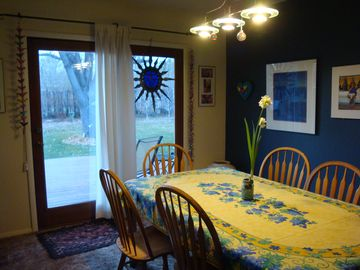 Cortez house rental - The colorful dining room looking out to the redwood deck and welcoming yard.