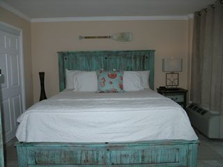 Galveston condo photo - Master bedroom with King bed and pillow top mattress. Beach decor.
