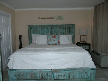 Master bedroom with King bed and pillow top mattress. Beach decor.