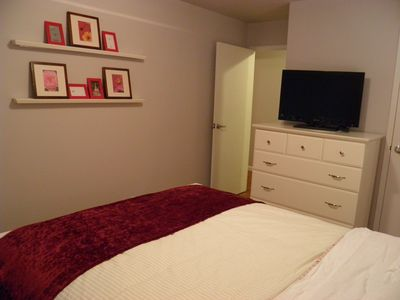 Bedroom with flat panel TV
