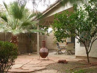 Phoenix house photo - North-facing backyard patio with chiminea and furniture.