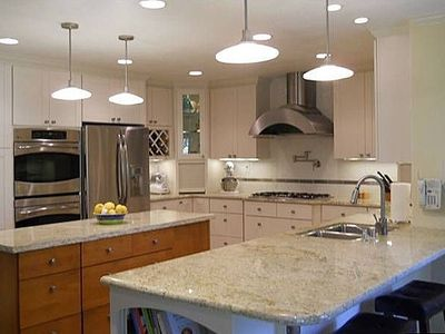Gourmet kitchen with new stainless appliances and granite counters