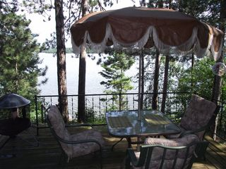 Hayward cabin photo - Deck w/ patio table, fire pit, gas grill and four additional garden chairs
