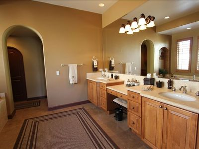 Master bath which includes dual sinks, walk-in closet & walk in shower.