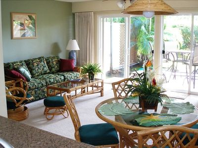 Island style furnishing in dining and living areas
