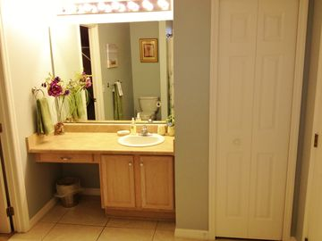Convenient make up area for her and linen closet in master bath. Wheelchair acc.
