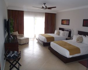 Playa Cofresi condo photo - 2 Queen Beds, Full Bath with Jacuzzi Tub and Separate Shower, exit to Veranda