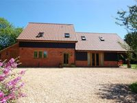 An extremely well presented detached family house situated in a quiet woodland setting