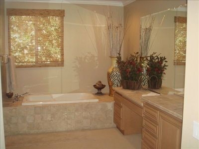 luxurious master bath with spa tub
