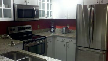 New granite countertops and stainless steel appliances