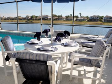 Enjoy a class of wine or afternoon lunch by the Pool