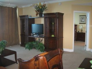Gulf Shores condo photo - Entertainment center in living room.