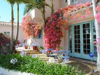 Bouganvillea covered French Doors open to front courtyard.