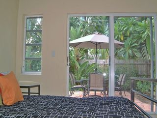 Fort Lauderdale villa photo - Master Bdrm /w Bath & TV,Direct Access to the Pool
