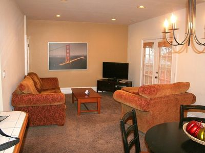 Living room area with 37' HD flat panel TV with digital cable.
