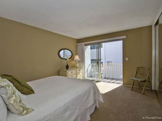 Pacific Beach condo photo - The master bedroom with balcony and bay views