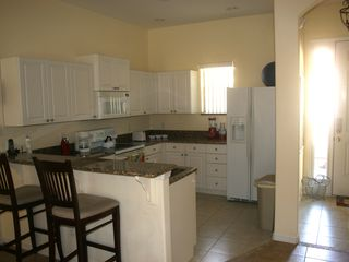 Tuscan Hills villa photo - Entrance and kitchen with breakfast bar. All granite design and new appliances