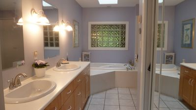 Master bathroom. Twin sinks, soaker tub, walk-in shower (out of photo)