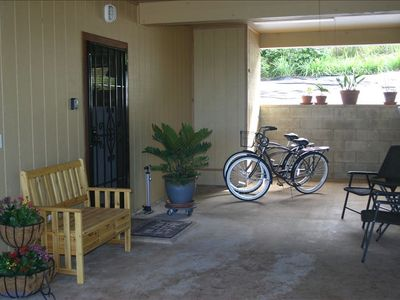 Front Door off Covered  Patio Area with seating and Beach Cruisers.....