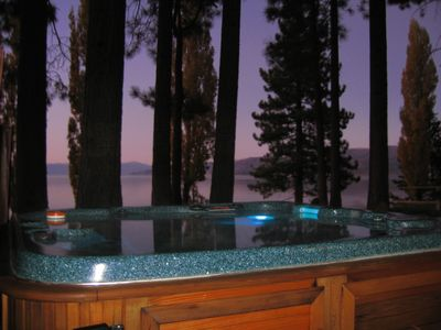 Relax in the pristine hot tub while taking in the stunning beauty of the Lake