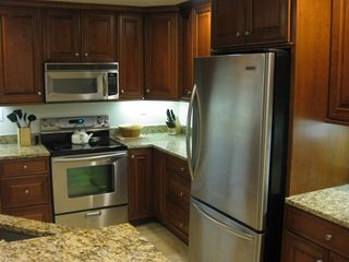 Belmont Towers Ocean City condo photo - View Of Kitchen showing Kitchen Aid Stainless Convection Stove, Fridge