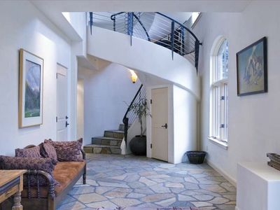 The entrance hall of the town home gives the feeling of light & space.