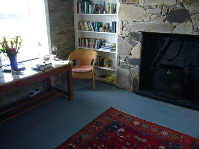 sitting room by the fire with small library