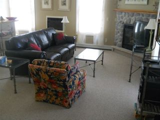 Onekama condo photo - Includes sleeper sofa, TV w/ DVD player & air conditioning (wall unit)