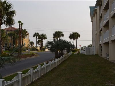 Maravilla Resort condo rental - Fenced green space off patio. Just a short walk to the beach!