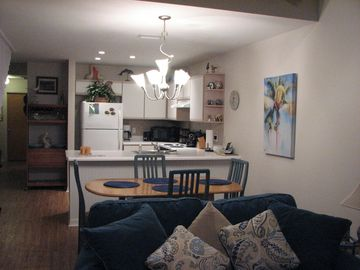 Photo showing part of new Denim Loveseat and Sofa, looking toward kitchen.