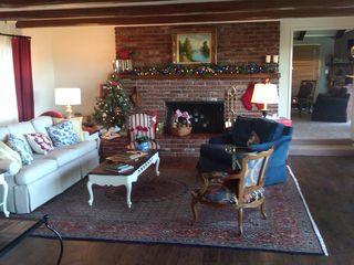 Fallbrook house photo - Ranch living room decorated for Christmas with a peak into the family room