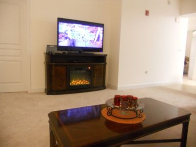 Big screen TV, speaker for your IPAD or MP3 and faux Fireplace/heater