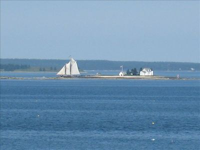 Closeup of schooner sailing past the Blue Hill Bay lighthouse