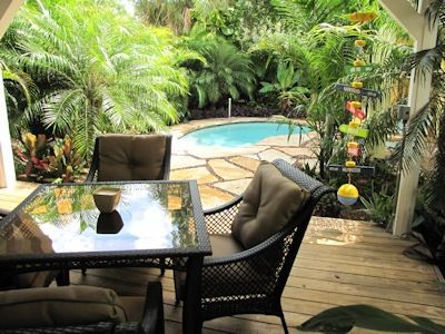 About Time Cottage offers lush and tropical outdoor areas for dining and pooling