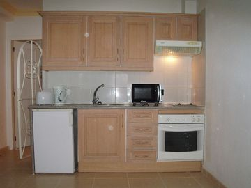 Kitchen with fridge,oven,kettle,toaster,microwave