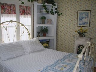 Lincoln City house photo - This charming sunny bedroom has great view of the ocean and a step-out balcony.