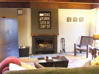Ithaca lodge photo - Den with fireplace