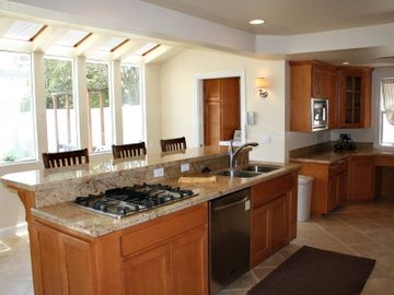 Kitchen: Granite, Travertine, Stainless Steel Appliances, DCS Dbl Oven