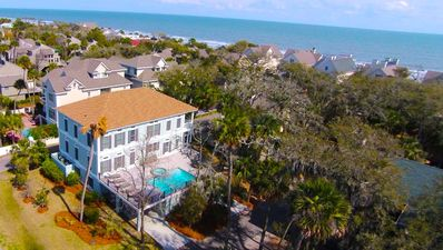 Steps from the beach .... spacious pool, deck, spa, grill & chill