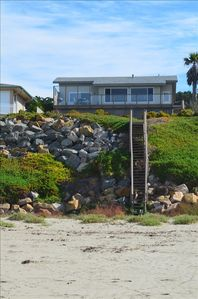 The view of the oceanfront house from the beach