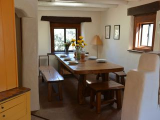 Santa Fe house photo - Dining nook. Oak refectory table and benches.