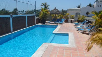 Large sunny lap pool and plenty of loungers