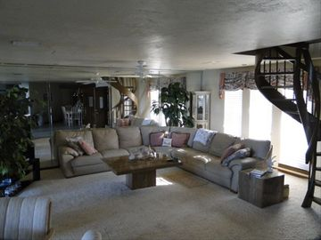 First flr living rm w/65' HD Big Screen TV ; spiral staircase up to loft area