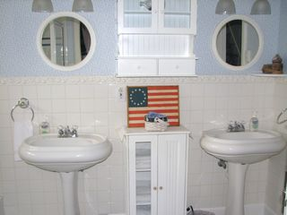Lincoln City house photo - Main Bathroom on 2nd Floor has double sinks, tub and separate shower.