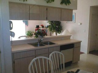 Briargrove villa photo - The kitchen is linked to the lounge via a breakfast bar