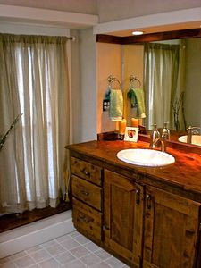 Bozeman house rental - Master bath with skylight, custom vanity, and privacy wall for toilet