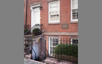 Entrance to your garden apartment, with plaque denoting historic 1827 building.
